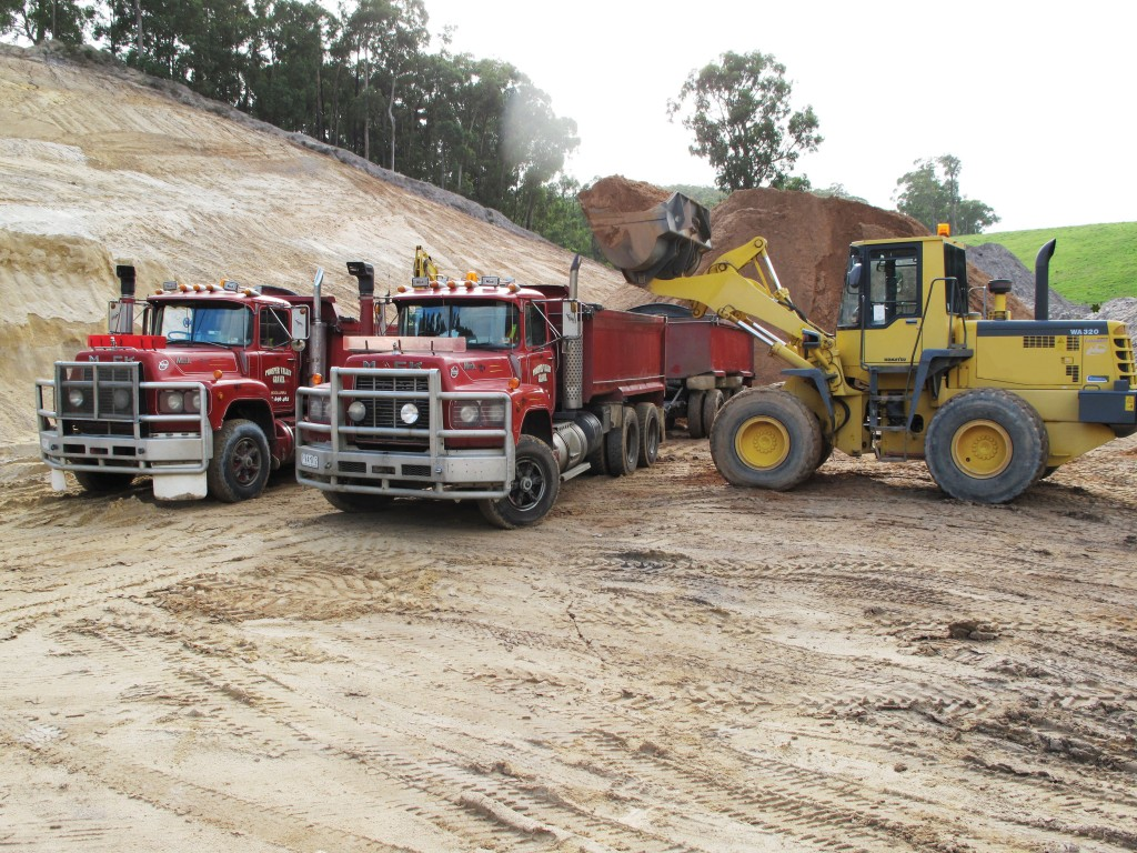 SITE PHOTO: Trucks being loaded
