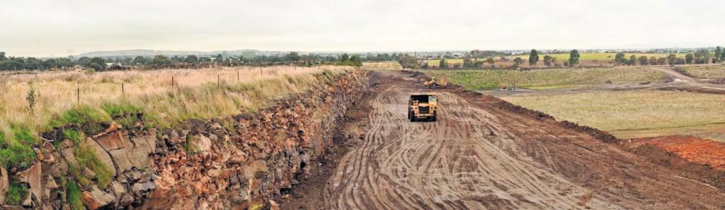 SITE PHOTO: Preparing a laminated stockpile of overburden