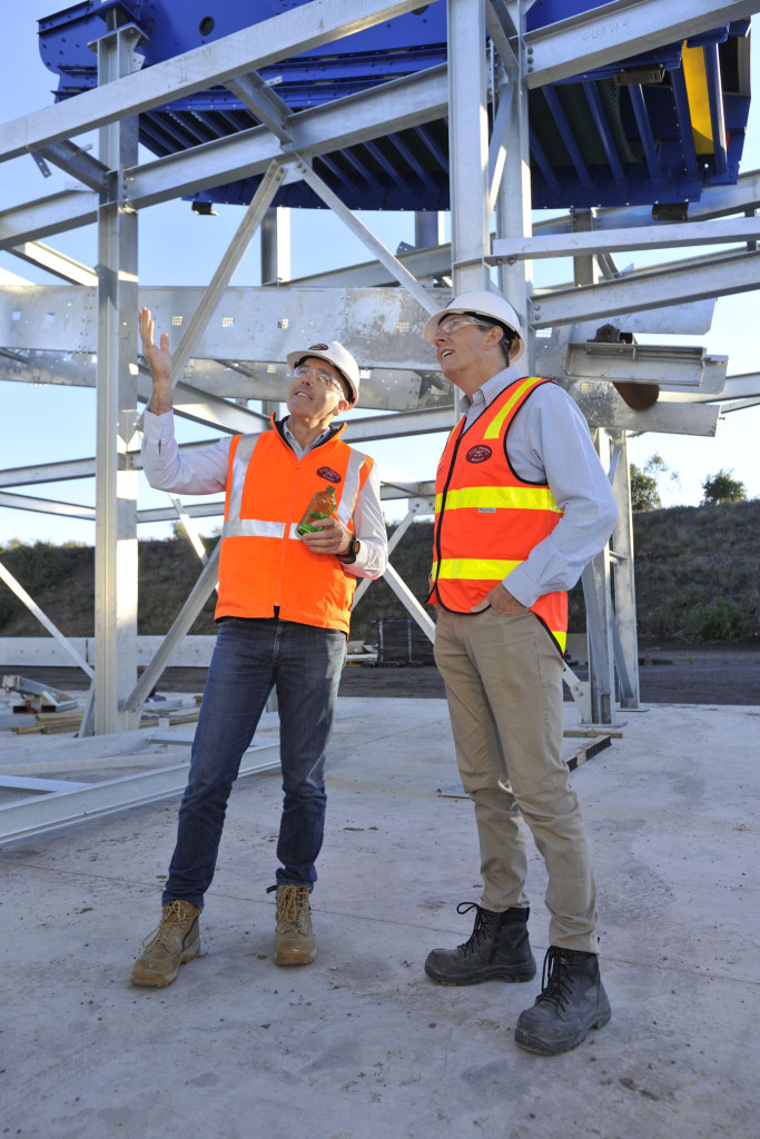 Alex Fraser MD Peter Murphy inspects the work at the company's new glass recycling plant with Hanson CEO Phil Schacht