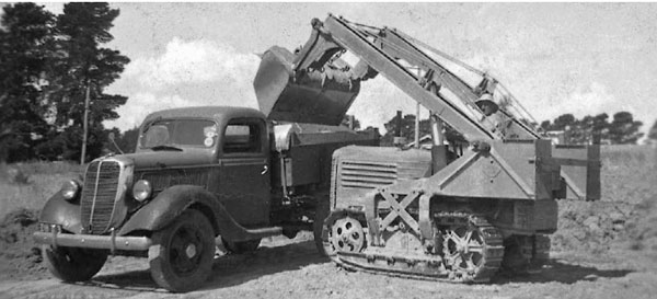 Truck loading in the 1930's with a then modern hydraulic crawler tractor